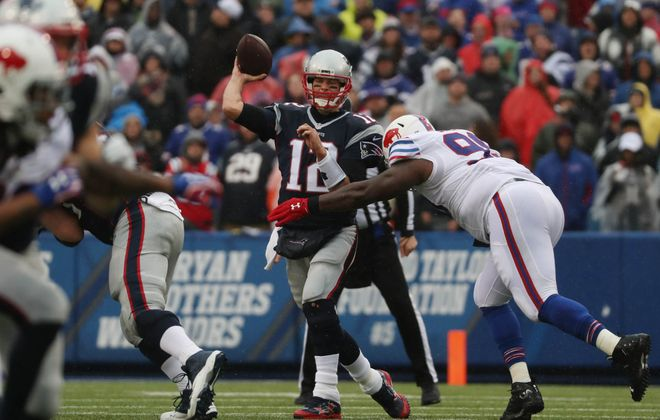 New England Patriots quarterback Tom Brady (12) throws while under pressure from Buffalo Bills' Marcell Dareus (99) in the first quarter. (James P. McCoy/Buffalo News)