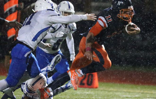 Isaiah McDuffie rushed for 102 of his 142 yards and two touchdowns during the second half to help spark Bennett's 24-7 comeback win over Grand Island in a Section VI Class A quarterfinal game Friday at rainy All High Stadium. (James P. McCoy/Buffalo News)
