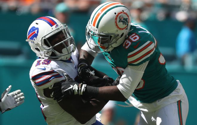 Miami Dolphins cornerback Tony Lippett (36) hammers Buffalo Bills wide receiver Walt Powell (19) after a catch in the second quarter. (James P. McCoy/Buffalo News)