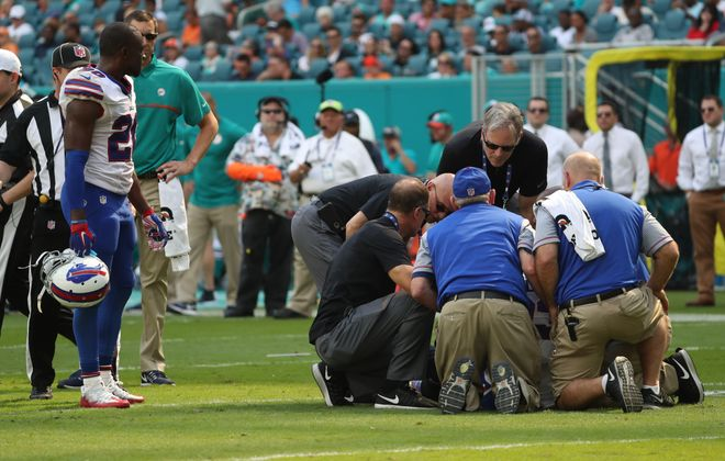 Buffalo Bills strong safety Aaron Williams is attended to by the Bills' medical staff after being hit by Jarvis Landry. (James P. McCoy/Buffalo News)