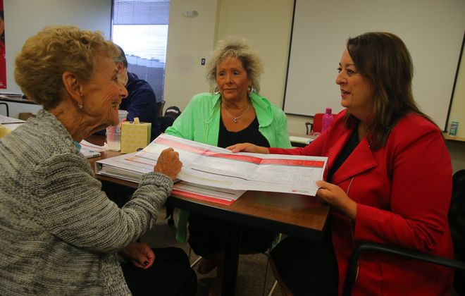 """""""The first (question to ask) is, 'Is my doctor in your network?' From there, ask about hospitals and pharmacies."""" – Independent Health's Linda Carr, right, answer questions from Elaine Witkin, center, and Catherine Scelsi at the Medicare Information Center in Cheektowaga."""