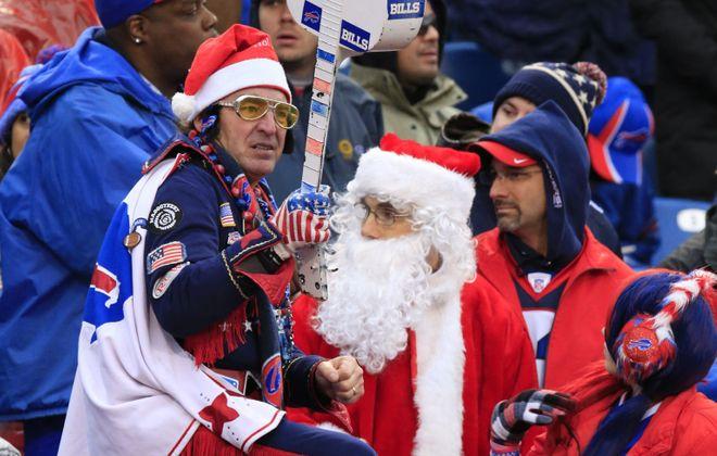 Elvis and Santa take part in the Buffalo Bills vs Dallas Cowboys during second quarter action at Ralph Wilson Stadium on Sunday, Dec. 27, 2015.  (Harry Scull Jr./Buffalo News)