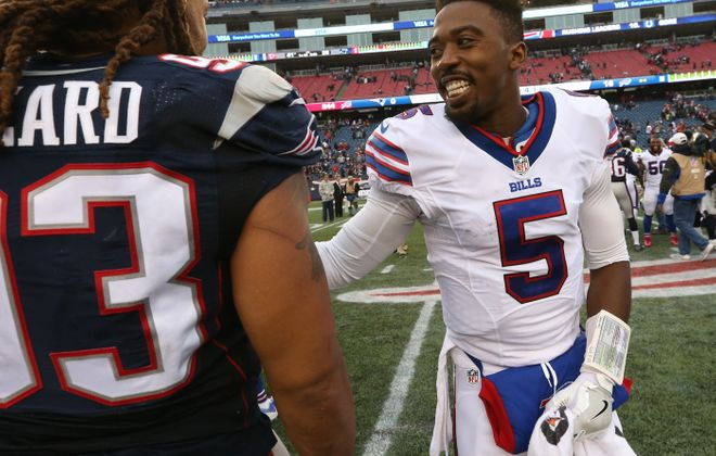 Buffalo Bills quarterback Tyrod Taylor (5) greets New England Patriots players at the end of the game.