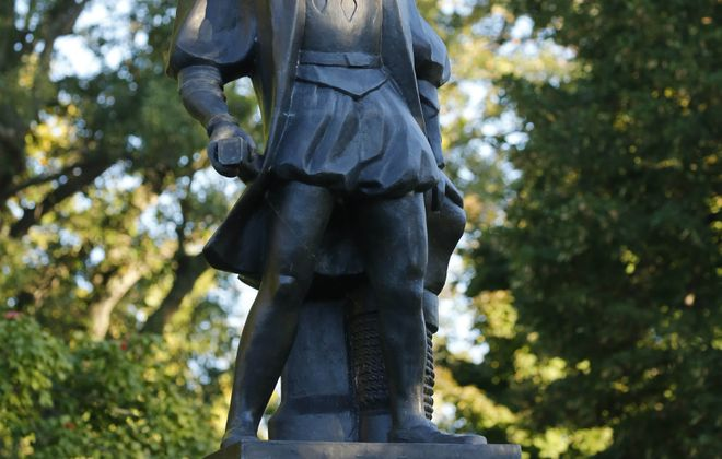 "A plastic bag was placed on the statue of Christopher Columbus in Prospect Park Monday in an anonymous protest of Columbus Day. A message in chalk on the walkway leading to the statue read: ""Columbus was a slaver & a rapist."""