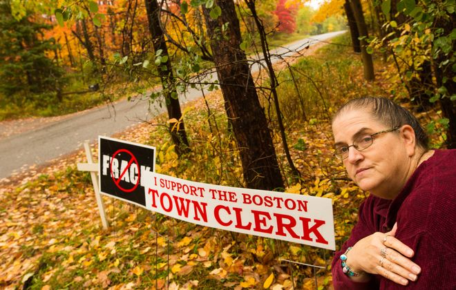 """After she posted a sign supporting the Boston town clerk on her property, Barbara Moore received a summons from the Town of Boston ordering her to appear in court for violating the town's temporary sign ordinance.  She says she was not required to pay the $10 fee for her """"No fracking"""" sign. (Derek Gee/Buffalo News)"""