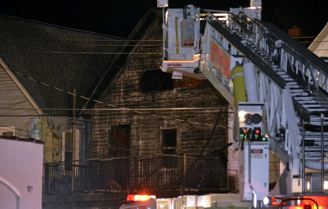 A fire Monday night on Ashley Place in Lockport sent a woman to the hospital with serious burns. (Larry Kensinger/Special to the News)