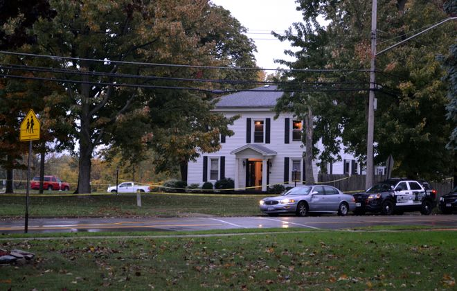 The home on High Street in Lockport where a body was found early Thursday. (LARRY KENSINGER/CONTRIBUTOR)