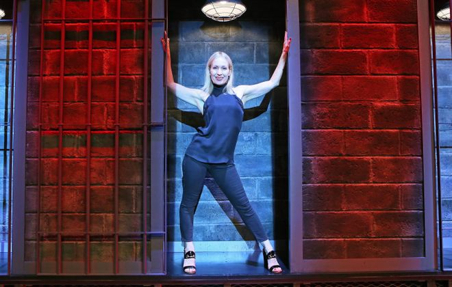 "Buffalo native Marguerite Derricks stands inside a set design from Cell Block Tango (from ""Chicago"") after a performance of ""ShowStoppers"" at Wynn hotel-casino in Las Vegas. (Ronda Churchill/Special to The News)"