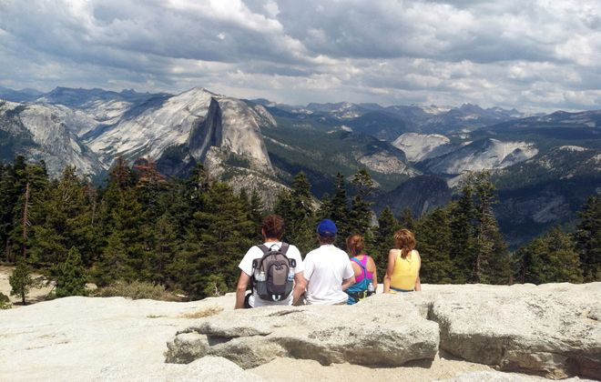After climbing to the top of Sentinel Dome in Yosemite National Park, the author and his family take in a spectacular view of Half Dome.
