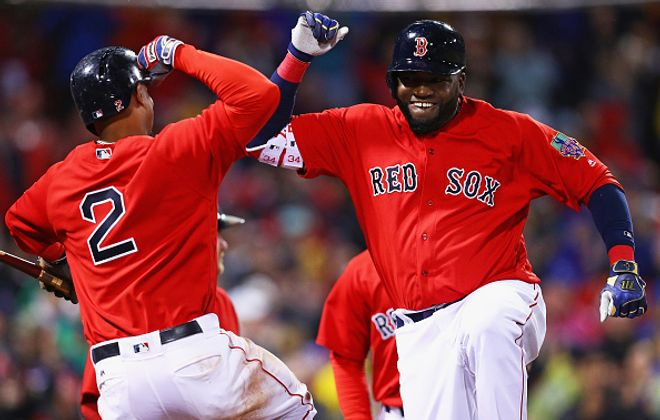 David Ortiz (right) celebrates with Xander Bogaerts after his home run beat the Blue Jays Friday night (Getty Images).