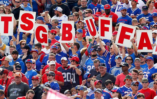 Bills fans celebrate a touchdown during the second quarter at New Era Field in Orchard Park.   (Mark Mulville/The Buffalo News)