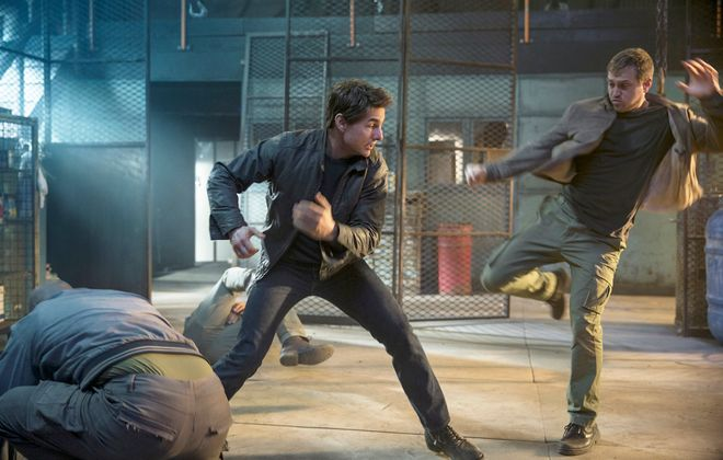 "Tom Cruise (as Jack Reacher) and Gordon Alexander in ""Jack Reacher: Never Go Back."""
