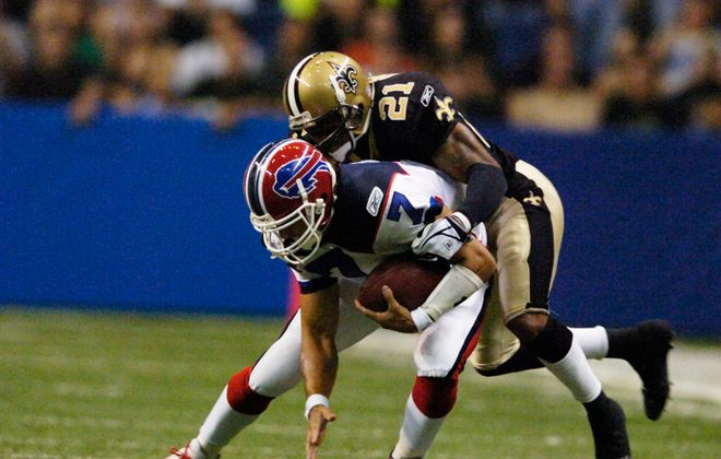 Buffalo Bills quarterback J.P. Losman is taken down by New Orleans' Jason Craft in an Oct. 2, 2005 game.  (News file photo/James P. McCoy)