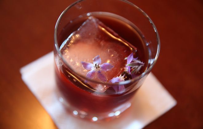 Buffalo Cocktail Classic will feature craft cocktails from 12 area bars including Winfield's Pub, where bar manager Tom Daulton's creative cocktails include the New Rose. (Sharon Cantillon/Buffalo News file photo)