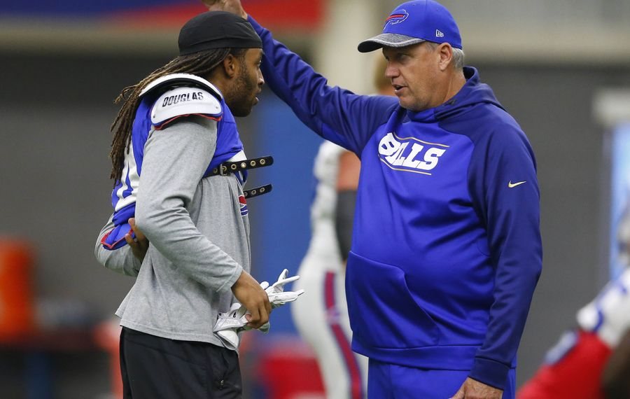 Former Bills cornerback Stephon Gilmore talks with former coach Rex Ryan during a practice in 2016. (Mark Mulville/Buffalo News)