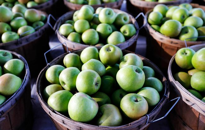 Amherst schools are among those that try to serve locally grown apples during the school year.   (Mark Mulville/News file photo)