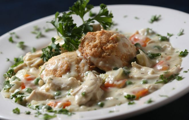 The Village Inn's chicken and biscuits is made with housemade buttermilk biscuits with chicken gravy filled with celery, carrots, peas, onions and pulled chicken breast. (Sharon Cantillon/Buffalo News)