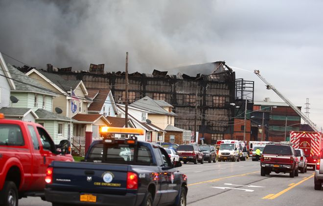 Firetrucks and EMTs on Route 5, which has been closed since about 8 a.m. Wednesday. (John Hickey/Buffalo News)
