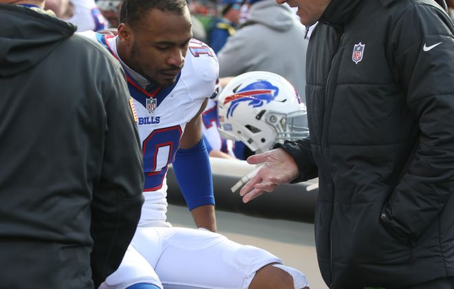 Buffalo Bills wide receiver Robert Woods (10) knee is checked out on the sideline during the first quarter. (James P. McCoy/Buffalo News)