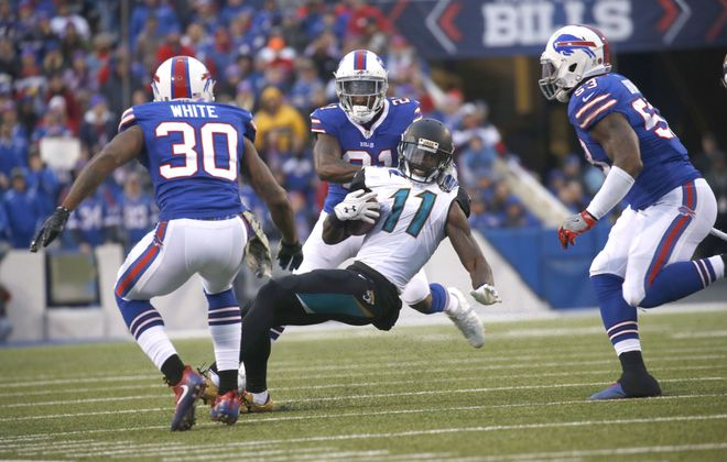 Jacksonville's Marqise Lee finds himself surrounded by, from left, Corey White, Nickell Robey-Coleman and Zach Brown. (Robert Kirkham/Buffalo News)