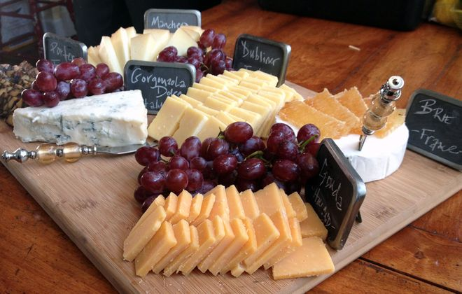 An imported cheese plate is a good make-ahead option to serve at a holiday open house.