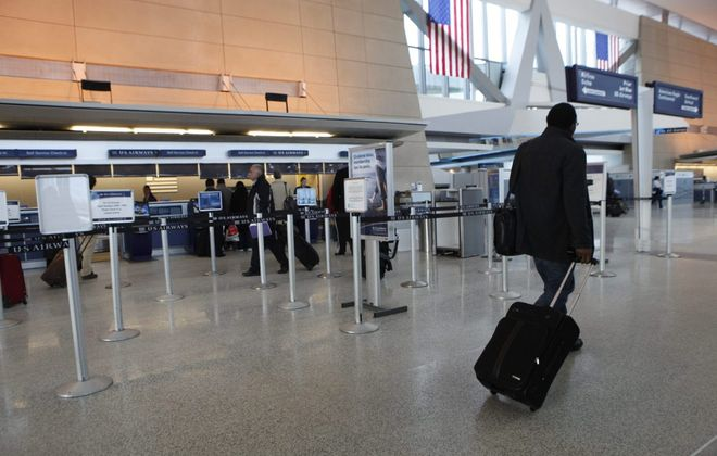 Travelers pass through the terminal at Buffalo Niagara International Airport. (Derek Gee/News file photo)