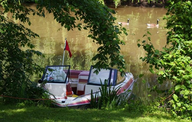 The boat that was involved in the crash led to the death of 16-year-old Avery Gardner sits moored on Ellicott Creek in Tonawanda Thursday, June 11, 2015.  (Mark Mulville/Buffalo News)
