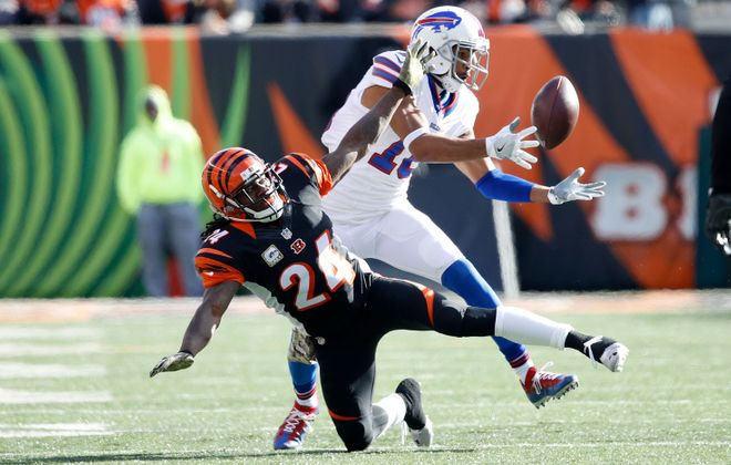 Robert Woods catches the ball after it was tipped by Adam Jones (24) during the first quarter. (Getty Images)