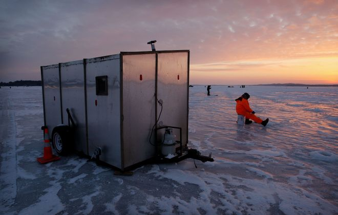 Ice fishing is really catching on ... at least when the weather cooperates! (Getty Images)