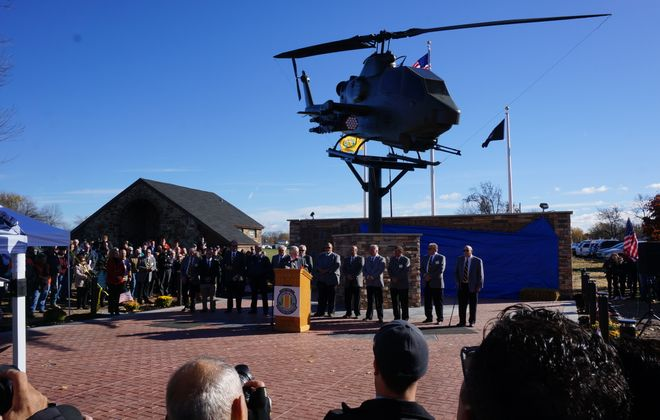 Members of Chapter 77, Vietnam of Veterans of America gather in front of their new memorial at a dedication Saturday.