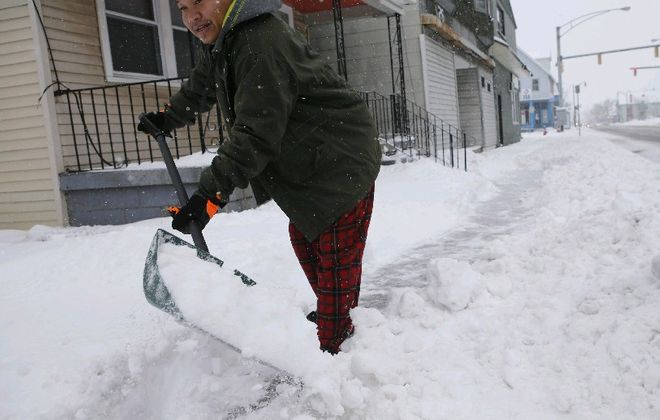 As the forecast becomes clearer, it's possible there will be snow to shovel in the Buffalo area by late Sunday.  (Derek Gee/Buffalo News)