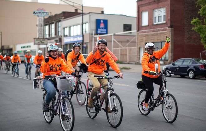 Slow Roll rolls on Monday at  6:30 p.m. Monday at Buffalo Fire Department Engine 20, 157 Ohio St. From left, Slow Roll helpers include Trixie Mercurio, David Saunders, co-founder Seamus Gallivan and LeDonia Boyd. (Photo by Dmitry Gudkov)