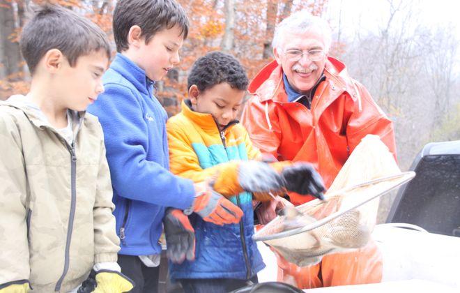 Mason Tomaszewski, Cooper Stenger and Devin Batten of Fredonia all help Steve Welk of Whispering Pines Hatchery get fish ready for stocking.