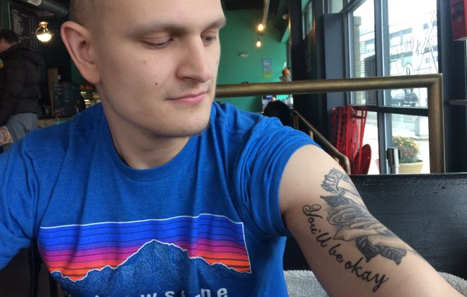 "Michael Feldman, at the Cafe Kubal coffee shop in Syracuse, with a tattoo of his mother's last words: ""You'll be okay."" (Sean Kirst/submitted image)"