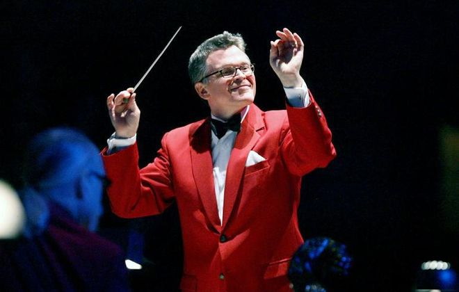 "John Morris Russell, the Buffalo Philharmonic Orchestra's Principal Pops conductor, has earned the title of ""Mr. Christmas."""