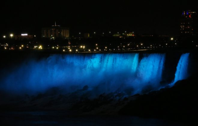 At 6:10 p.m., the Niagara Falls Illumination Board flipped the switch to turn on the new $4 million LED lighting, Thursday, Dec. 1, 2016. (Sharon Cantillon/Buffalo News)