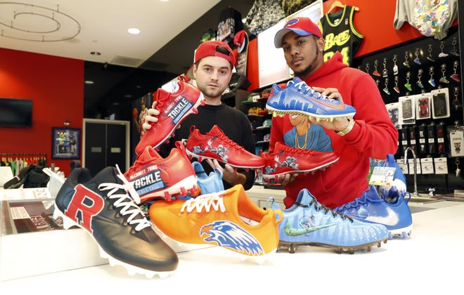 "Nicholas Avery, left, and Napoleon ""Polo"" Kerber at Fabes Sole High in the Walden Galleria Mall with some of the NFL's ""My Cause, My Cleats."" (Harry Scull Jr./Buffalo News)"