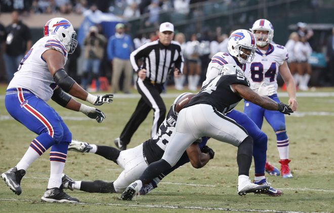 Khalil Mack sacks Tyrod Taylor, forcing a fumble that Mack recovered in the fourth quarter. (Harry Scull Jr./Buffalo News)