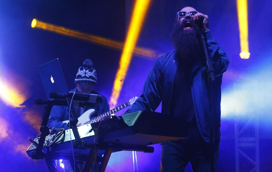Capital Cities co-lead vocalist Sebu Simonian performs at the Kerfuffle Before Christmas in the KeyBank Center. (Mark Mulville/The Buffalo News)