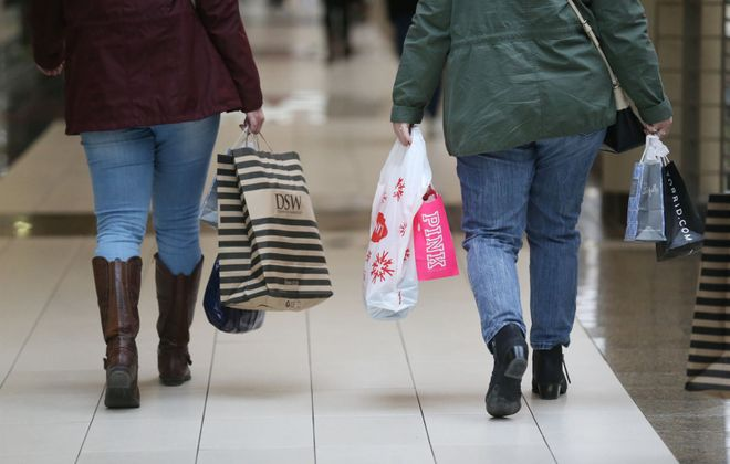 More mall shoppers are carrying paper bags these days. (News file photo)