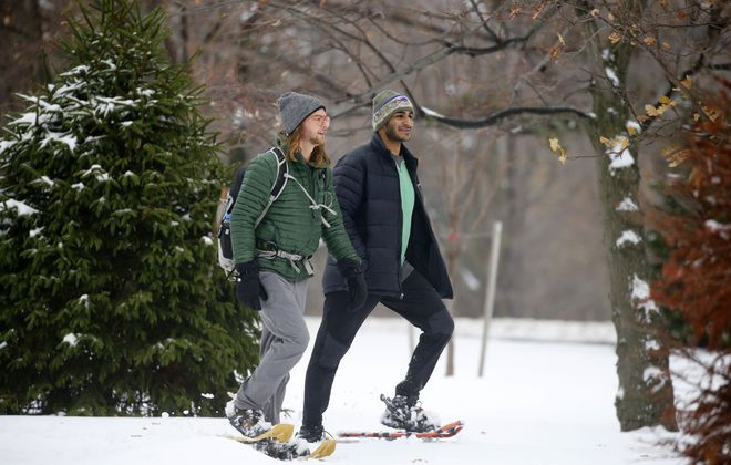 Simon Weinstein, left, and Matthew Asirwatham,  snowshoe through Delaware Park in Buffalo.   (Mark Mulville/Buffalo News)