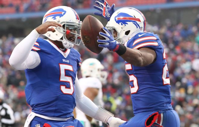 LeSean McCoy (right) celebrates a touchdown with Tyrod Taylor. (James P. McCoy/Buffalo News)