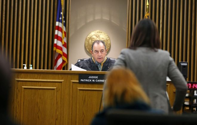 Judge Patrick M. Carney hears a housing case in Buffalo City Court. (Mark Mulville/Buffalo News file photo)