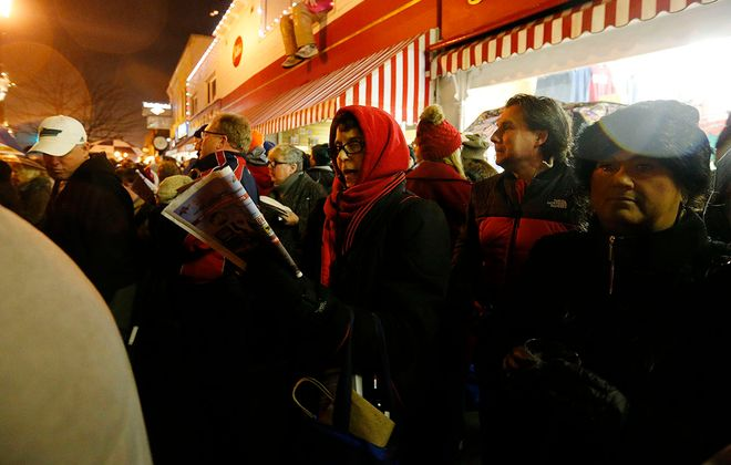 Tama Gresco-Sauers of East Aurora follows the words to the carols from a songbook during the 44th annual East Aurora Carolcade on Saturday, Dec. 17, 2016. (Mark Mulville/News file photo)