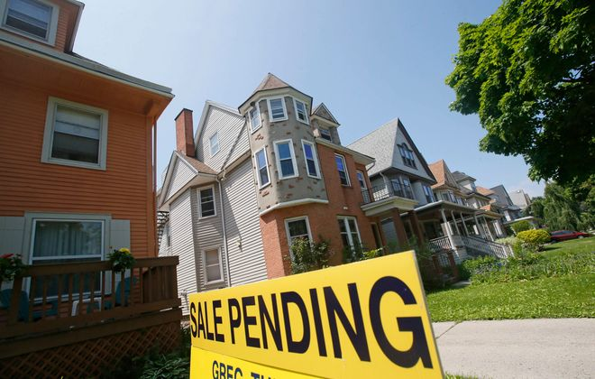 A real estate sign advertises a home under contract for sale on Norwood Avenue in the Elmwood Village. (Derek Gee/News file photo)