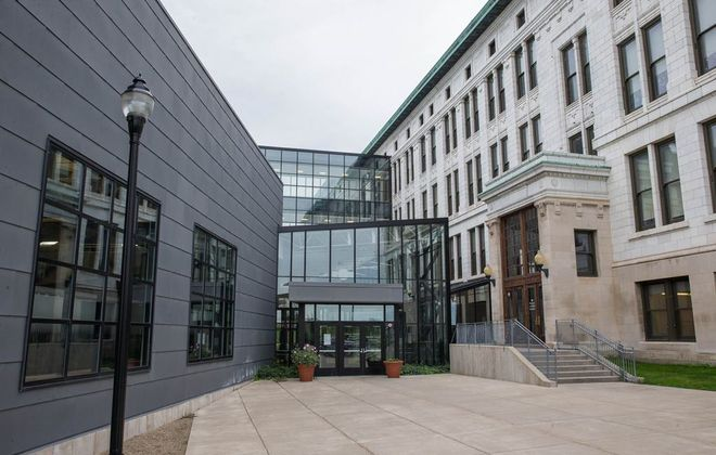The gymnasium and natatorium addition, left, to City Honors School were part of the $1.3 billion school renovation and construction project. (Derek Gee/Buffalo News)