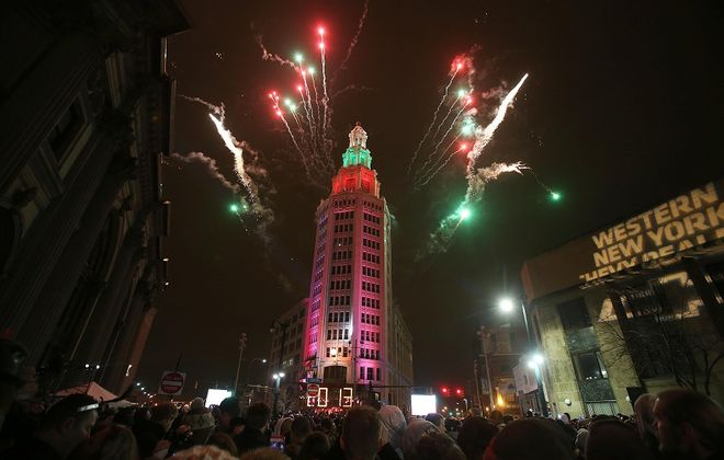 As the ball drops to welcome a new year, don't set lofty resolutions. Instead think of reasonable changes you can make in your life. (Robert Kirkham/Buffalo News file photo)