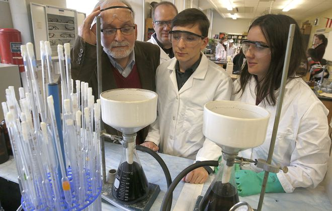 From left, UB professor Joseph Gardella, chemistry teacher Daniel Hildreth, and students Ryne McCarthy and Maggie Zaifert, both juniors, examine the progress of a graphene oxide experiment at South Park High School