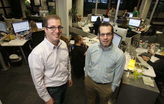 Campus Labs, co-founded by Michael Weisman, left, and Eric Reich, is moving to a new office at 298 Main St. (Buffalo News file photo}