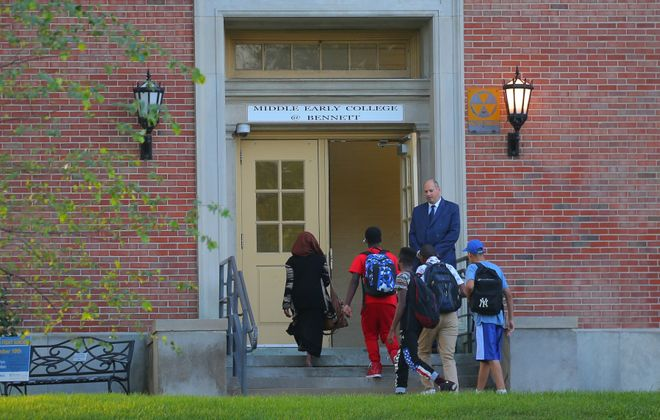 Dave Potter, assistant principal at Middle Early College at Bennett, greets students on their arrival on the first day of school in Buffalo, on Tuesday, Sept. 6, 2016. (John Hickey/Buffalo News)